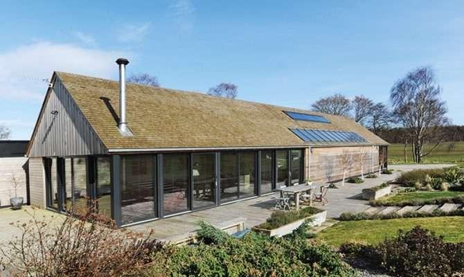House Features Extensive Glazing Cedar Cladding Roof