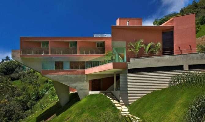 Sculptural Concrete House Built Steep Slope