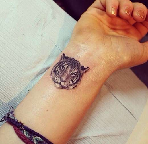 Small Nice Tiger Face Tattoo Wrist Stylish Girl