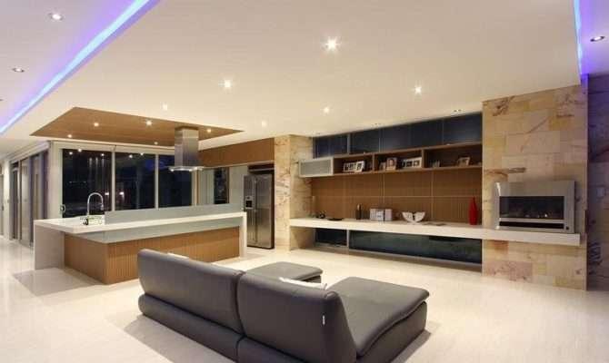Split Level Living Room Using Beige Colours Laminate Floor