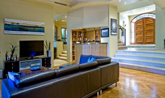 Split Level Living Room Using Cream Colours Floorboards