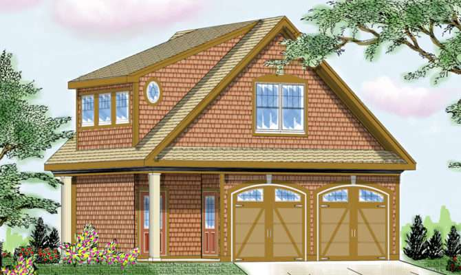 Two Story Garage Has Craftsman Style Details Arched Doors